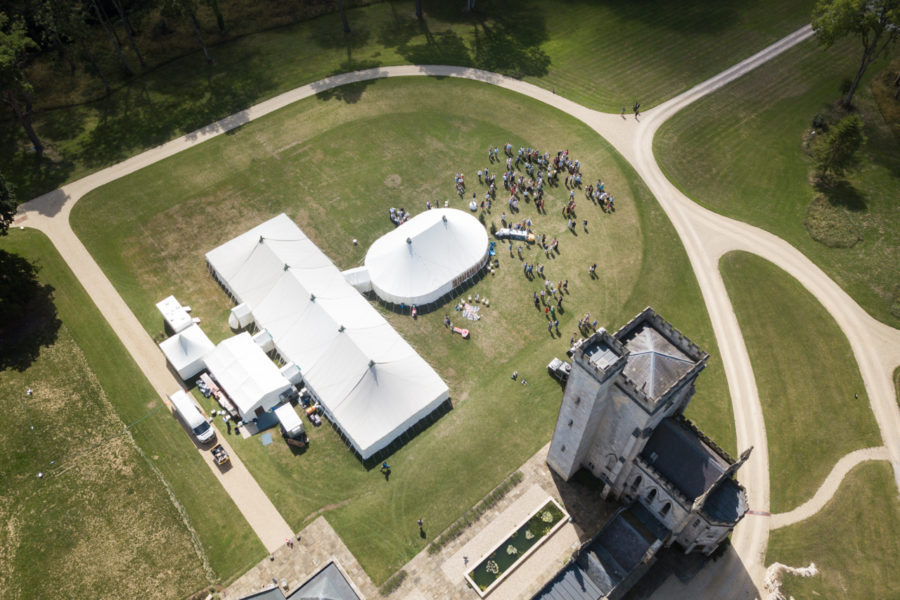 Aerial of oval marquee joined to 100'x40'