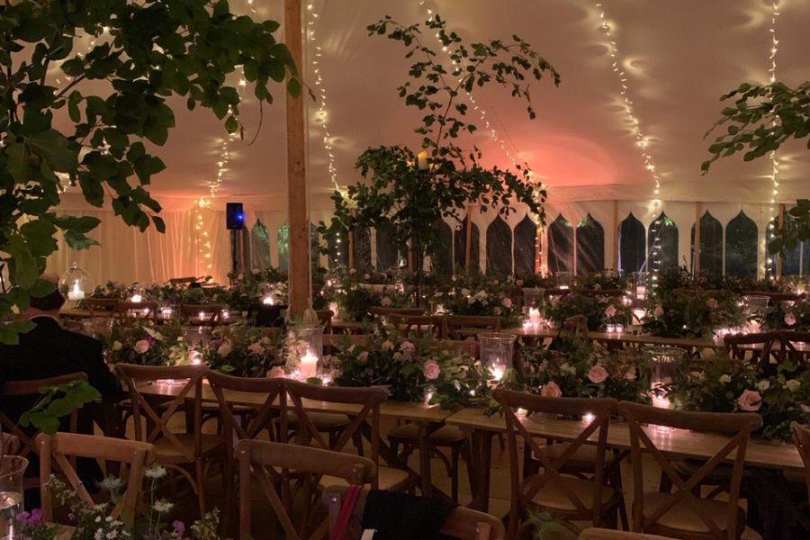 cross-backs pealights amber uplights rustic tables