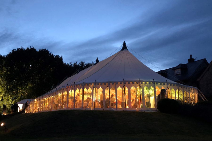 100' oval marquee with indian style window walls