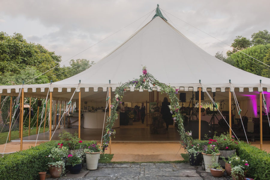 Traditional marquee with flower arch.jpg small size
