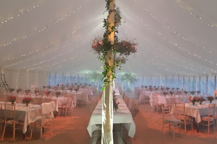 herringbone tables in large oval marquee