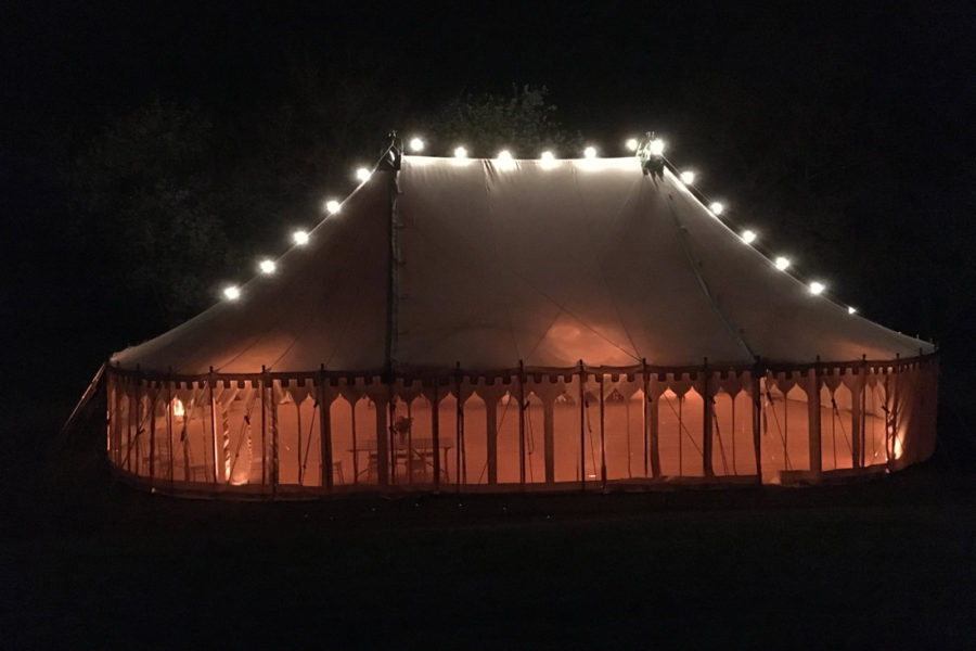 oval marquee with festoon lights over roof