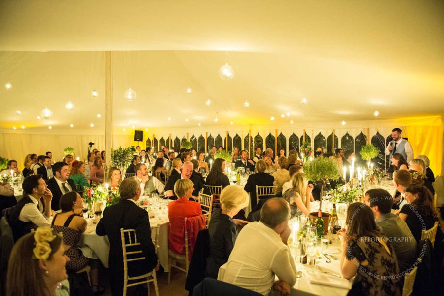 photo of inside marquee - bauble lights and indian windows